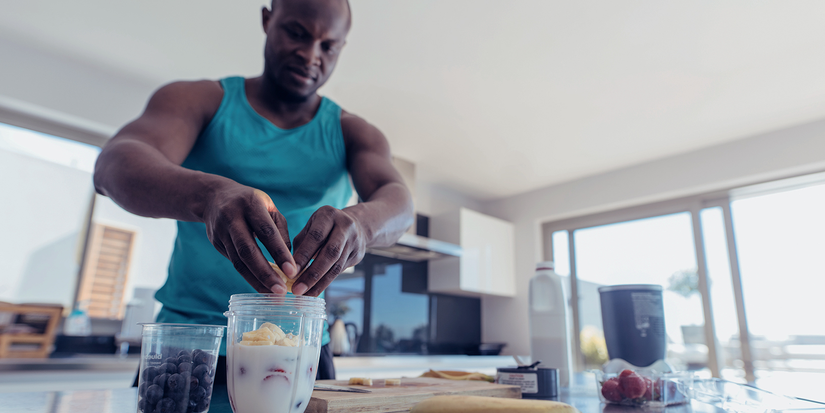 Photo of man prepping post workout smoothie