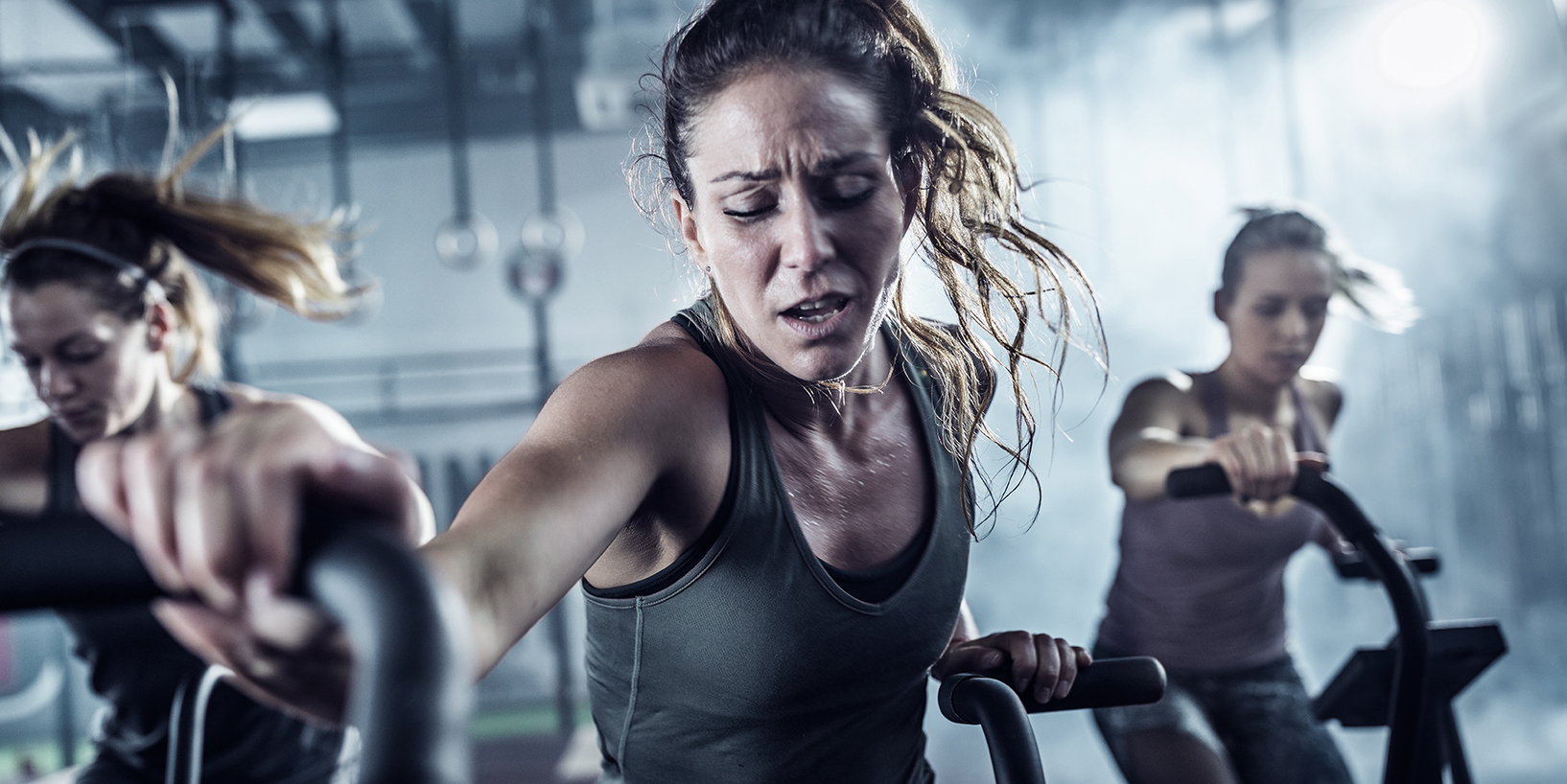 woman sweating while working out