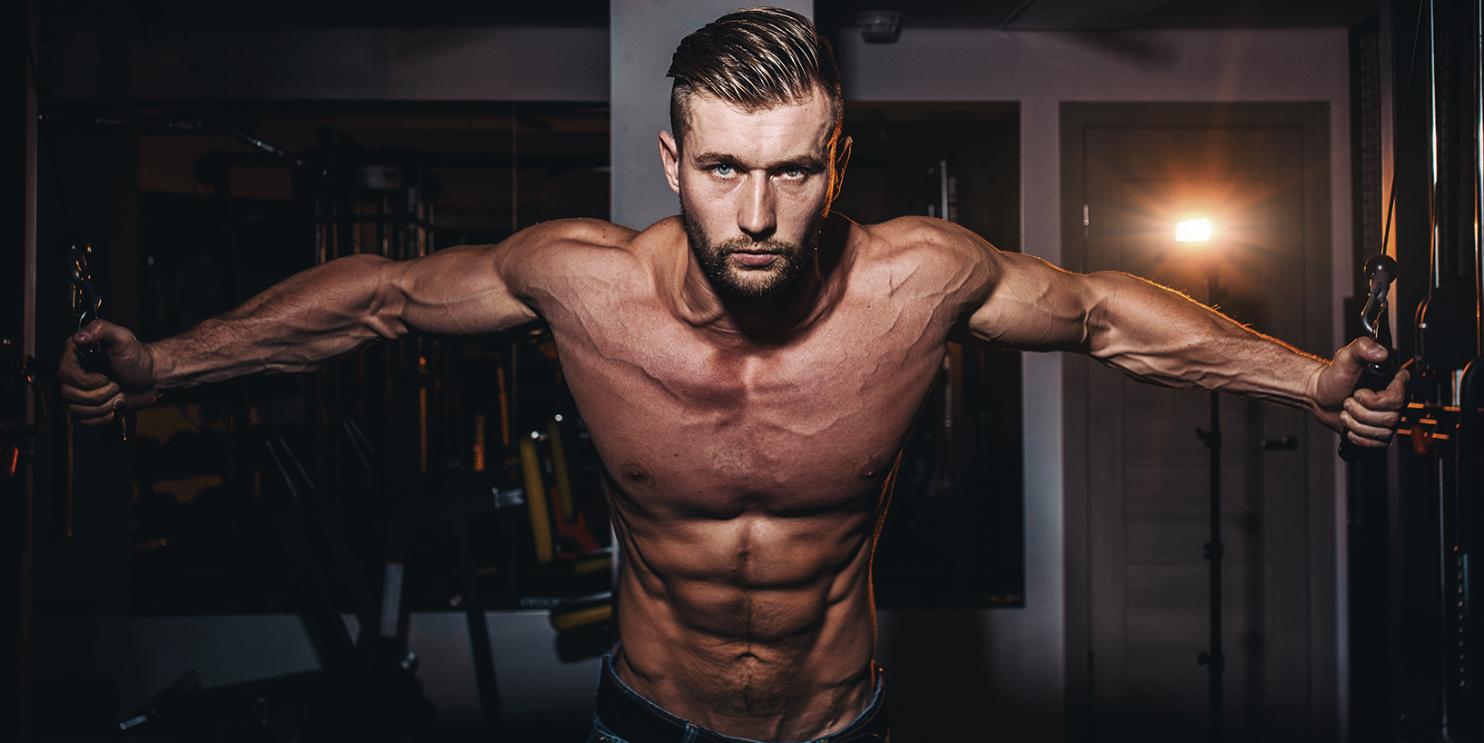 shredded man with very low body fat percentage showing off muscles